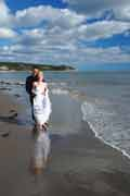 Image of bride and groom on beach